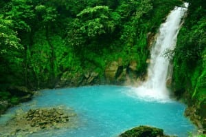 Rio Celeste's 100-foot waterfall spills into a turquoise pool