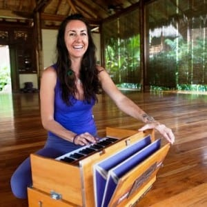 Pranamar Villas yoga instructor Nancy Goodfellow plays a harmonizer for chanting