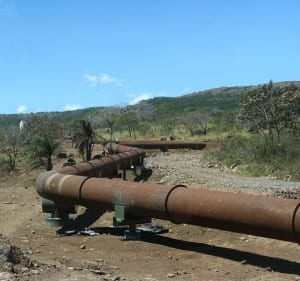 Piping for geothermal energy snake through dry forest around Rincon de la Vieja Volcano
