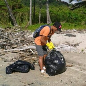 Bagging beach trash, Playa Santa Teresa, Costa Rica