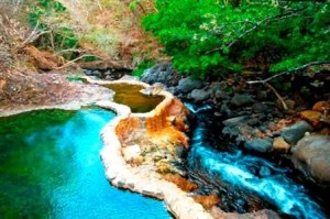 Natural-volcanic-thermal-springs-at-Hotel-Hacienda-Guachipelin-300x199
