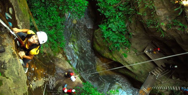 Rappelling at Hacienda Guachipelin