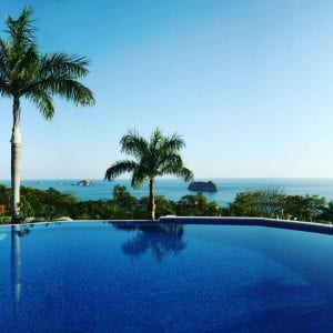 The pool with ocean below at Parador Hotel, Manuel Antonio, Central Pacific. Photo credit hotelparadorresortspa.