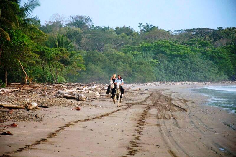 Horseback riding on Santa Teresa Beach Costa Rica
